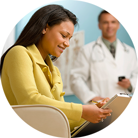 woman filling out medical forms with doctor in the background