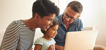 Grow-Up® Plan: mom, dad and toddler daughter using a laptop