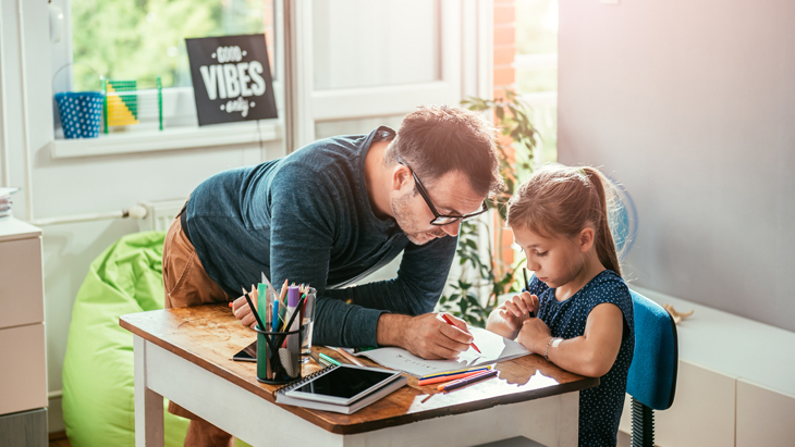 College Plan – Father and daughter working on homework