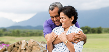 Term Life Insurance: Senior couple hugging and smiling