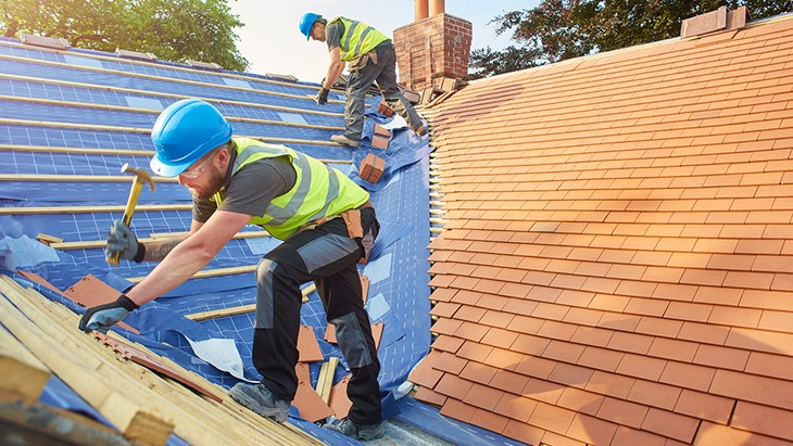 Most dangerous jobs – roofer installing a roof